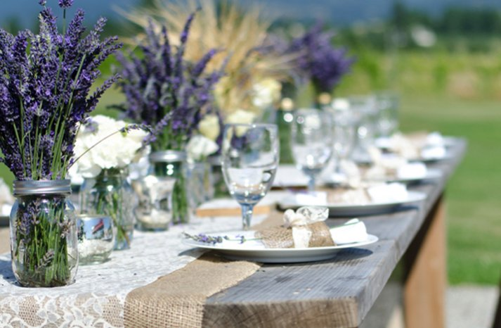 outdoor-wedding-reception-centerpieces-mason-jars-purple-wedding-flowers__full-carousel.jpg