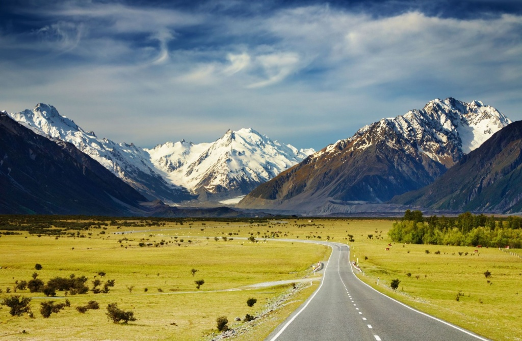 Visit-New-Zealand-Landscape-With-Road-and-Snowy-Mountains-Southern-Alps-New-Zealand-1600x1047.jpg